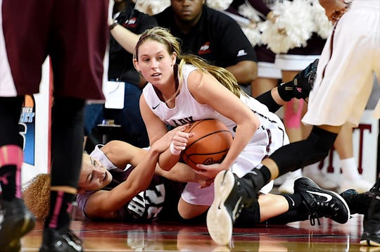 Henderson County's Maci Brown takes the ball from Ashland's Alexis Robinson during the 2015 state tournament in Bowling Green.