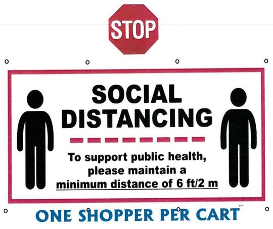 """This sign is being posted in stores such as Henderson's Sureway grocery locations, reminding people of the necessity of """"social distancing"""" during the time of coronavirus/COVID-19."""