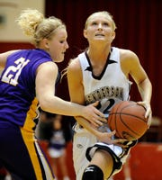 Lyon County's Melanie P'Pool fouls Henderson County's Ellie Fruit as she drives to the basket during the 2012 Second Region Tournament in Hopkinsville.