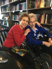 Lea Haravon Collins (left) and her mother Alda Haravon hug at Sidekick Coffee & Books, March 8, 2020, in Iowa City.