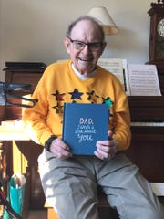 Norm Kallaus, 96, smiles for on his birthday, Monday, March 30, 2020, at Oaknoll Retirement Residence in Iowa City, Iowa.