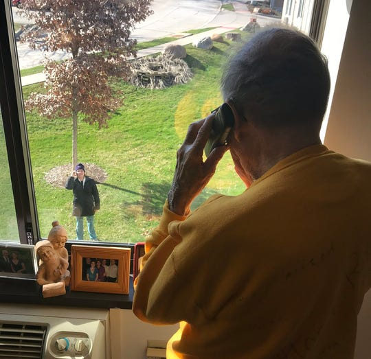 Norm Kallaus, 96, talks on the phone with his daughter Anne Wallace while they celebrate his birthday, Monday, March 30, 2020, at Oaknoll Retirement Residence in Iowa City, Iowa.