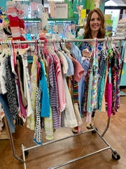 Mary Anna Wachtel prepares to hang clothing at Leap Frog Consignment & More in Madison. Organizing merchandise and keeping up with bookkeeping are two key components of a consignment business, she said.