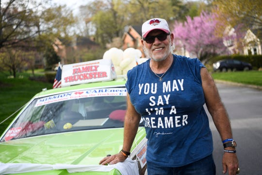 """Dave """"Coach"""" Moore stands next to his Truckster after driving through the Kensington neighborhood while playing music in West Knoxville on Saturday, March 28, 2020."""