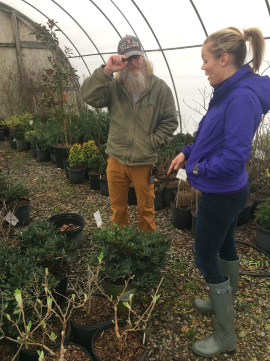 Amy Harr of Halls checks out the plant selection with Duane Ridenour at Beaver Creek Nursery in March 2020.