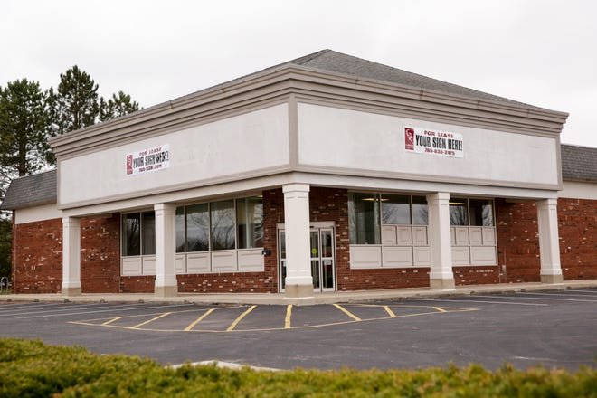 """""""For Lease"""" signs hang on the former CVS Pharmacy building at the corner of N Salisbury Street and Sagamore Parkway, Tuesday, March 31, 2020 in West Lafayette."""