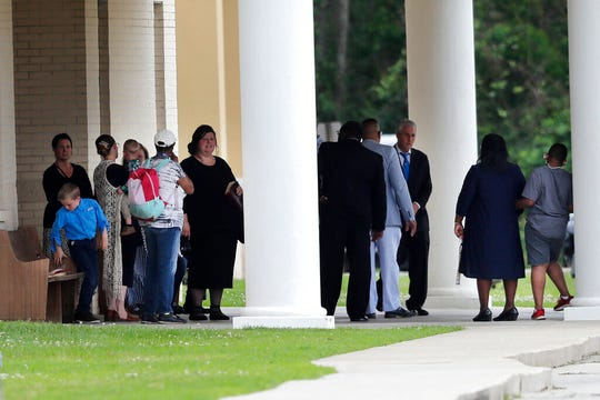 Congregants gather after services at the Life Tabernacle Church in Central, La., on Sunday, March 29. Pastor Tony Spell has defied a shelter-in-place order by Louisiana Gov. John Bel Edwards, due to the new coronavirus pandemic, and continues to hold church services with hundreds of congregants.