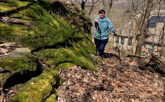 Robyn Petras hikes around her property in late March.  Petras was diagnosed with COVID-19, one of the first confirmed cases in Fairfield County. She has remained isolated since mid-March in order to slow the spread of the virus.
