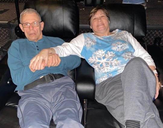 Robyn Petras, right, sits with her father Eddie Hoffman in a Pickerington movie theater earlier this year. The trips were a special occasion for the two of them as Hoffman has Parkinson's Disease and Petras has cystic fibrosis. Petras was diagnosed with COVID-19, one of the first confirmed cases in Fairfield County.