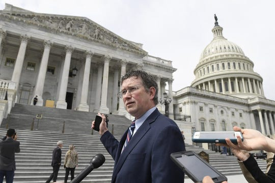 Rep. Thomas Massie, R-Ky., talks to reporters before leaving Capitol Hill in Washington, Friday, March 27, 2020.