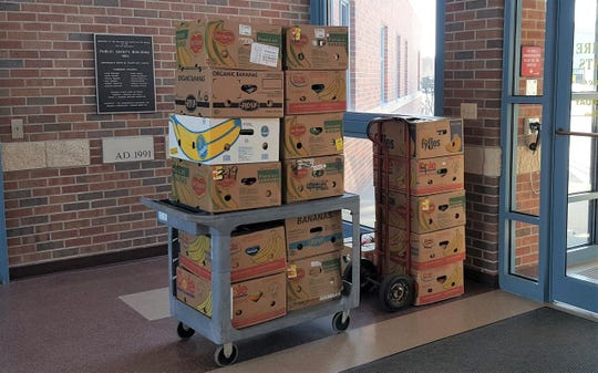 """Boxes of food collected in March as part of the Manitowoc Police Department's """"10 Most Wanted Food Drive."""""""