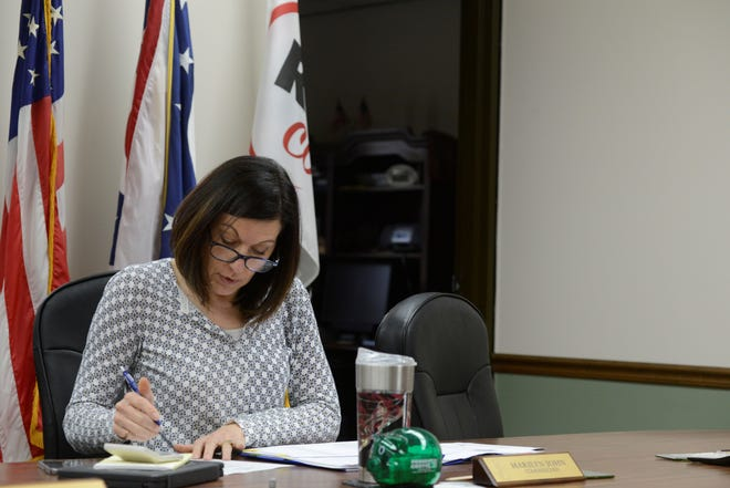 Richland County Commissioner Marilyn John looks over the paid sick leave and emergency medical leave policies outlined in the second aid package signed by President Donald Trump.