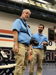 Mark McGuire, left, has been the head wrestling coach at River Valley for 39 years.