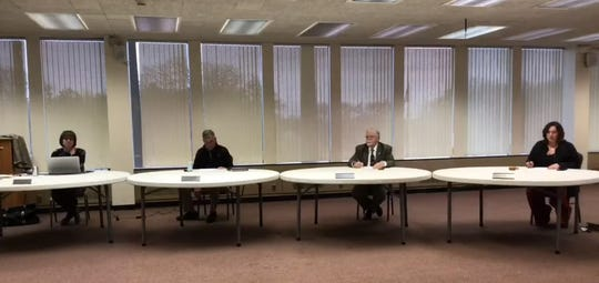 A screenshot of the Marion City Schools board meeting on March 16, which was live-streamed on YouTube. The school board members observed the six-foot social distancing rules recommended by public health officials in light of the coronavirus pandemic.