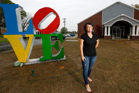 The Rev. Ann Starker stands outside of CrossPointe Church where volunteers are putting together food packages to feed a family of four for a full week, during one of two weekly distributions, from three separate DeSoto County church sites, on Monday, March 30, 2020.