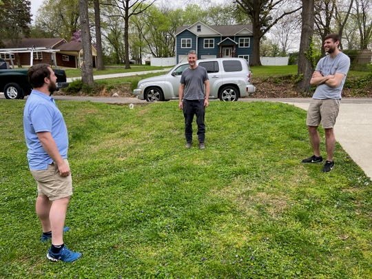 Andy Cooley, left, Aaron Johnson and Brody Laws form the Chattanooga extension of Two Broke Bartenders and a Truck, a newly formed small business aiming to reemploy laid-off service industry workers.