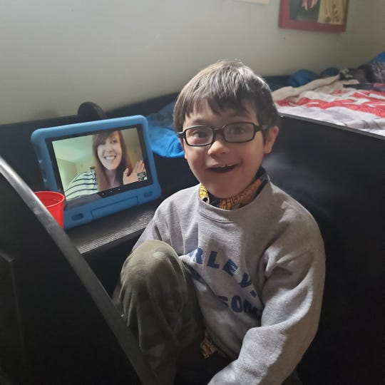 Henry Wisniewski is excited to see his teacher online since he can't see her in person during isolation as a result of the coronavirus pandemic.