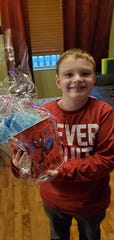 Michael, 7, loved the bear, rubber duck, candy and bubbles included in his basket. Helen Ergen, who oversees the children's ministry at Southbrook Church in Franklin, delivered nearly two dozen baskets to children across southeast Wisconsin.