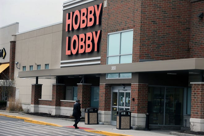 A customer arrives at Hobby Lobby in Brookfield on March 31. The business had a sign on its door that said it was an essential business and had been open. The store has since shut down to comply with Gov. Tony Evers' order.