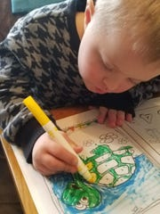 Cody Zwicke has been working on his fine motor skills at home with materials his mom, who is a teacher, has.