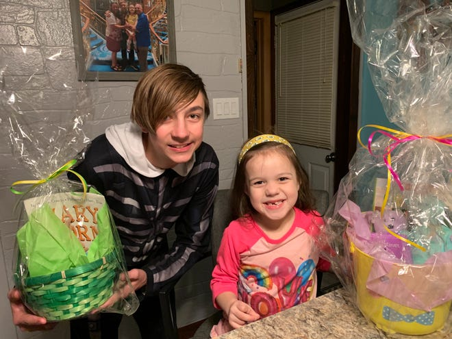 Connor, 14, and Cassandra, 5, liked getting their Easter baskets from Helen Ergen, who oversees the children's ministry at Southbrook Church in Franklin. After an Easter egg hunt at the church was canceled due to the coronavirus, Ergen delivered the baskets to families.