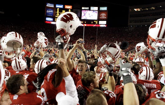 Badgers fans rush the field after Wisconsin upset the top-ranked Ohio State at Camp Randall Stadium on Oct. 16, 2010.