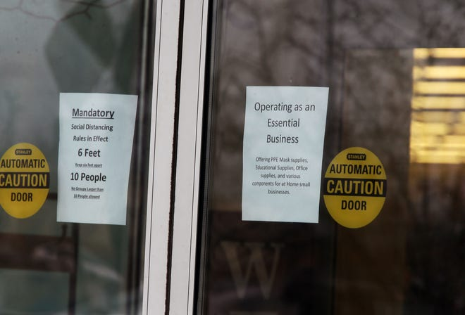 Some Hobby Lobby stores have posted signs saying they were open because they were an essential business.