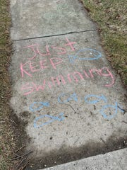 Kelly Goldmann's children have been leaving chalk messages for those out on walks in Wauwatosa.