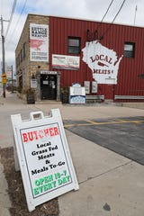 Kettle Range Meats in Milwaukee remains open because it is a food store, but because of coronavirus only five people are allowed at a time in the sales area.