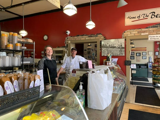 Rochester Deli owner Dan Strackbein and associate Becke Engel combined to fill carryout orders on Monday afternoon, March 30. The popular 15-year-old deli, a downtown Waukesha lunch hotspot, has seen an obvious dip in businesses since residents were ordered to stay at home in response to the coronavirus pandemic.