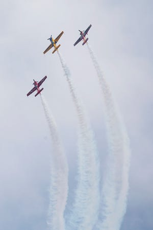 The Firebirds Aerobatic Team performed a routine over Bradford Beach, with Matt Chapman in the center plane, during the 2019 Milwaukee Air and Water Show.