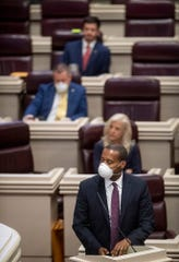 Rep. Anthony Daniels speaks as the house comes into session with barely a quorum present in the House Chamber at the Alabama Statehouse in Montgomery, Ala., on Tuesday March 31, 2020.