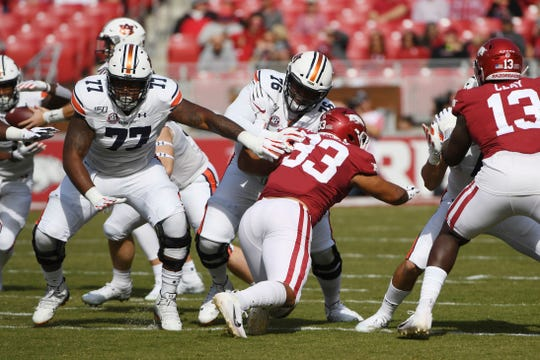 Auburn offensive linemen Marquel Harrell (77) and Prince Tega Wanogho (76) block against Arkansas on Saturday, Oct. 19, 2019 in Fayetteville, Ark.