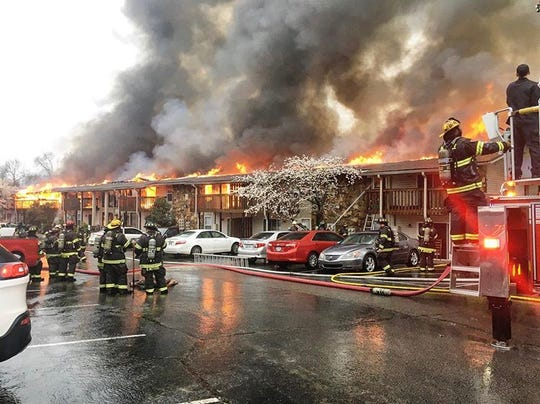 Firefighters battle a blaze at Summerfield Place Apartments on March 24, 2020, in Goodlettsville, Tenn.