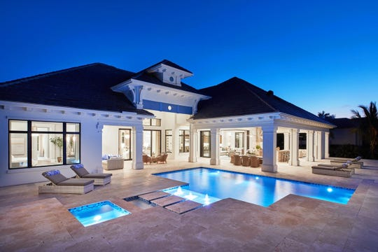 The Sophia III model, by Stock Custom Homes, has an expansive outdoor living area that overlooks the 10th fairway of the community's Lakes Course.