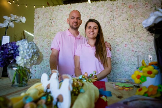 Patrick and Mirela Beneš owners of Naples Picasso Arts and Flowers pose for a portrait, Tuesday, March 31, 2020, at their flower shop in East Naples.