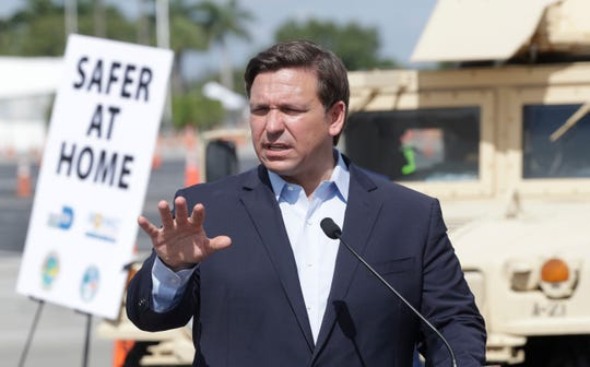 Florida Gov. Ron DeSantis speaks during a news conference at a drive-through coronavirus testing site in front of Hard Rock Stadium, Monday, March 30, 2020, in Miami Gardens, Fla. Gov. Ron DeSantis doesn't want the people on the Holland America's Zandaam where four people died and others are sick to be treated in Florida, saying the state doesn't have the capacity to treat outsiders as the coronavirus outbreak spreads.
