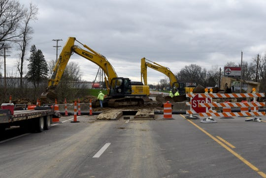 Repairs continue on the section of Ohio 79 near Heath which collapsed after flash flooding hit the area.
