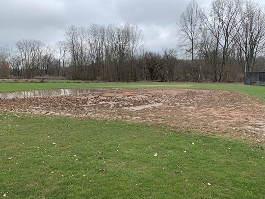 Flooding from recent heavy rainstorms stripped playing surfaces from ball diamonds and soccer fields at Raccoon Valley Park, and dislodged a pour-in-place playground surface.