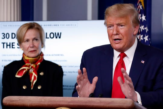 President Donald Trump speaks about the coronavirus in the James Brady Press Briefing Room of the White House, Tuesday, March 31, 2020, in Washington, as Dr. Deborah Birx, White House coronavirus response coordinator, listens. (AP Photo/Alex Brandon)