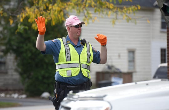 In this 2017 photo, Park Ridge Police Officer Scott Laughton directing traffic during the Pink Hat Campaign to raise money for cancer research.