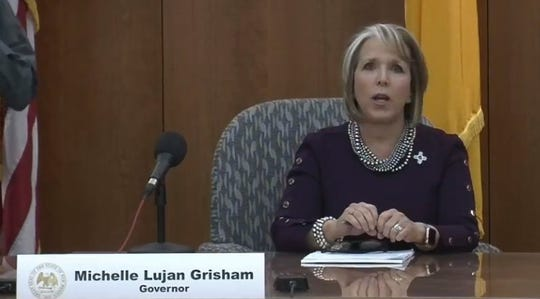 New Mexico Gov. Michelle Lujan Grisham opens a livestreamed press conference in Santa Fe on Tuesday, March 31, 2020.