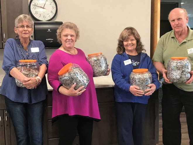 Four members of the Las Cruces Association of Educational Retirees, Debbie Sarabia, Linda Morgan and Hannah and Bill Monsimer, collected hundreds of soda drink tabs to be redeemed for the needs of the Ronald McDonald Room at Memorial Medical Center.