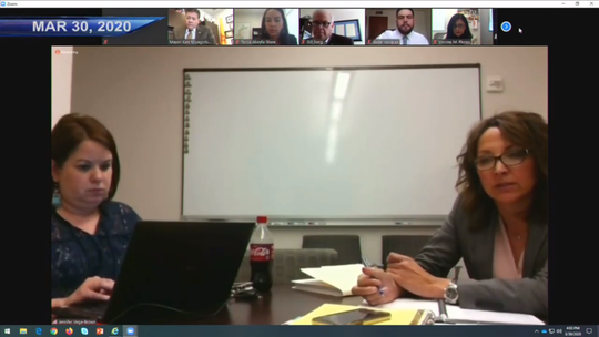 Las Cruces City Clerk Christine Rivera, left, and City Attorney Jennifer Vega-Brown participate in a special meeting via Zoom video chat on Monday, March 30, 2020. The mayor and councilors are pictured at top.