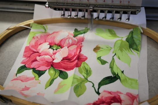 The outer fabric used in the protective masks comes in a floral, flag or neutral pattern.