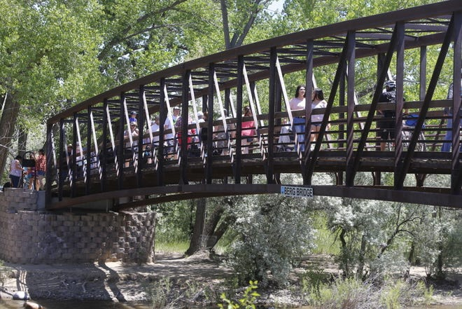 Riverfest visitors cross Berg Bridge over the Animas River during the 2017 event. This year's festival is threatened by the coronavirus shutdown.