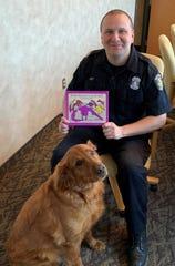 "Wayne Police Officer Jordan Arndt  read ""If the Dinosaurs Came Back"" for online viewers."