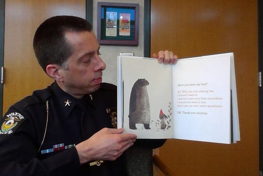 """Wayne Police Chief Ryan Strong  read """"I Want My Hat Back"""" to online viewers for National Reading Month."""