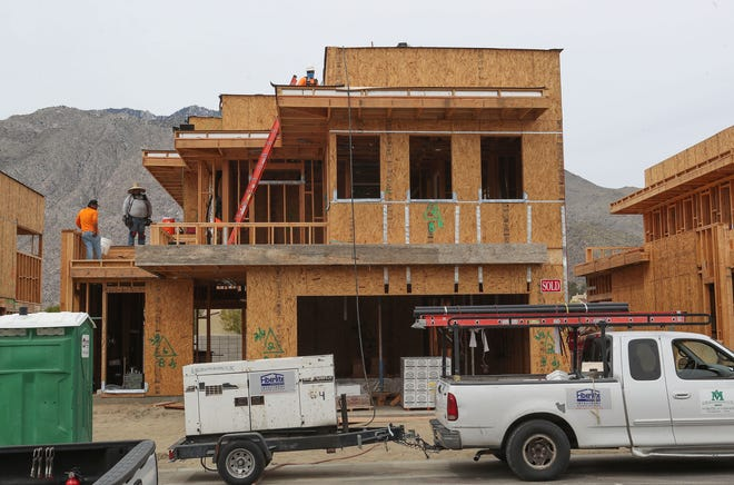 Construction workers are building a condominium that has already been sold at The Enclave at Barisito where potential buyers can take a virtual tour of Palm Springs housing, March 31, 2020.