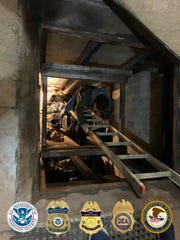This photo released Tuesday, March 31, 2020, by the San Diego Tunnel Task Force, Department of Homeland Security, shows an entrance in Mexico to a cross-border tunnel running from warehouses in Tijuana to San Diego. U.S. authorities seized a large haul of drugs including opioids, methamphetamine and cocaine, being smuggled through the tunnel equipped with ventilation, lighting and an underground rail system. Authorities believe it existed for several months. (Department of Homeland Security via AP)